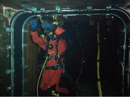 HydraTite being installed underwater by a field services technician