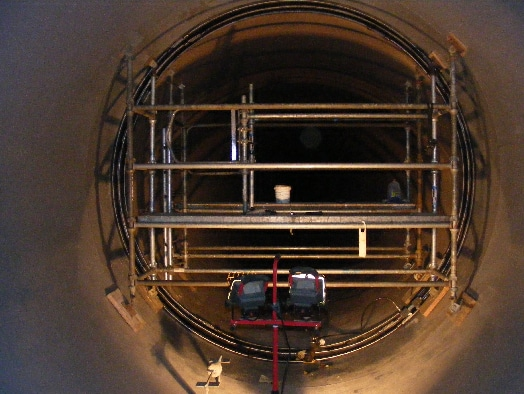 HydraTite Being installed in a lareg diameter Pipe with scaffolding
