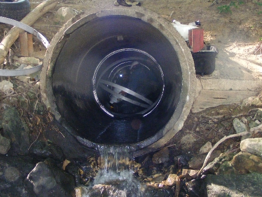 multiple seals being installed in a small diameter pipe by field services technicians