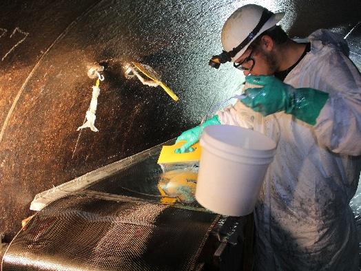 a field services technician preparing to install HydraWrap