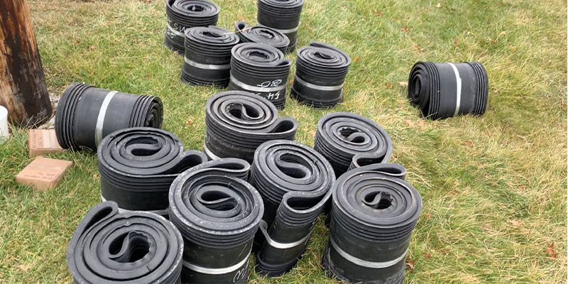 HydraTite Rubber Seals in the grass waiting to be installed