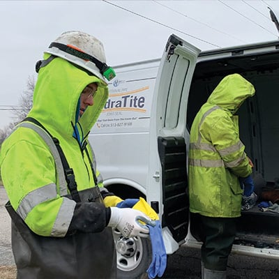 HydraTech Field Technicians preparing to install HydraTite despite the freezing water