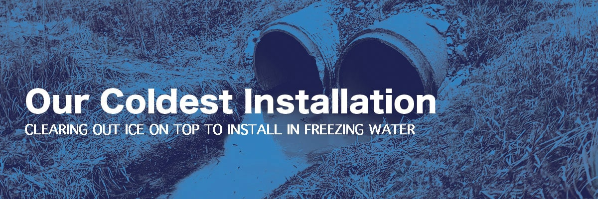 two culverts with frozen water in them, 'Our Coldest Installation, CLEARING OUT ICE ON TOP TO INSTALL IN FREEZING WATER'