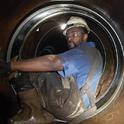 HydraTech Technician installing HydraTite in a small diameter pipe